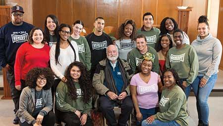 Fr Greg Boyle posing with a group of Regis students during his visit to campus