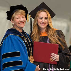 Alexa Nicholls Costa at her graduation with President Hays
