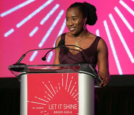 Ikhianosen Ukhuedoba '19 speaking at the podium during the 2019 Let It Shine Gala