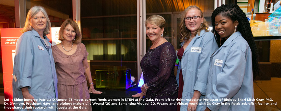 Let It Shine honoree Patricia D'Amore '73 meets current Regis women in STEM at the Gala. From left to right: Associate Professor of Biology Shari Litch Gray, PhD, Dr. D'Amore, President Hays, and biology majors Lily Wyand '20 and Samantina Viduad '20. Wyand and Viduad work with Dr. Gray in the Regis zebrafish facility, and they shared their research with guests at the Gala.